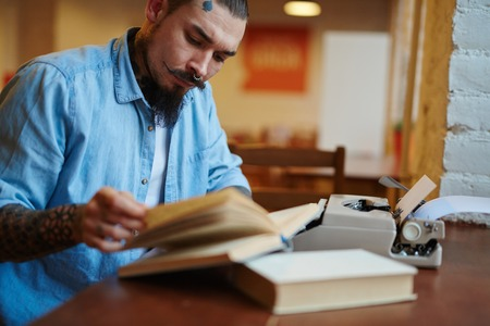 Hipster Old-School Writer Working on His Book