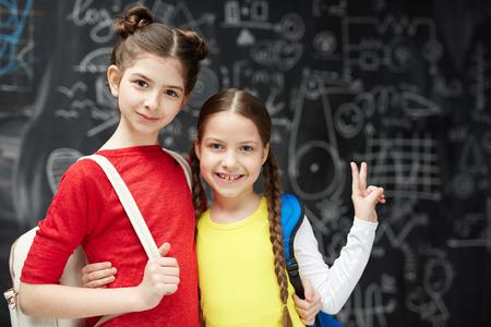 Affectionate schoolgirls