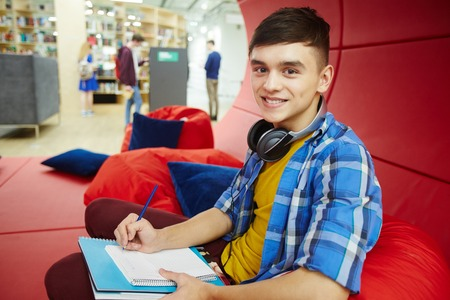 breakout: Smiling College Student in Modern Workspace