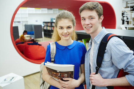 man studying: Smiling Student Couple in College Library