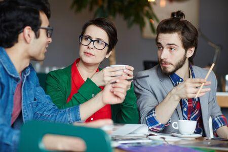 editor: Team of Creative People Working in Meeting Stock Photo