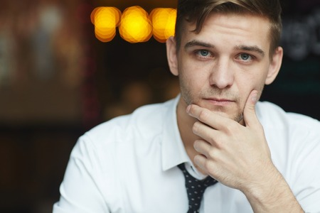 neutral: Young Businessman Thinking at work Stock Photo