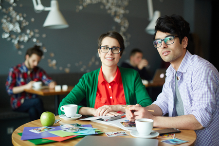 editor: Creative Colleagues Meeting in Cafe Stock Photo