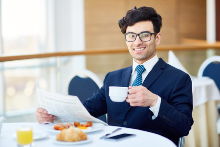 Reading news by lunch Stock Photo