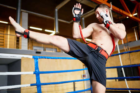 Kickboxer Training with Resistance Belts