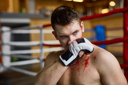 tough: Tough Man Wiping Blood after Fight Stock Photo