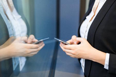Office Worker Browsing Internet on Smartphone