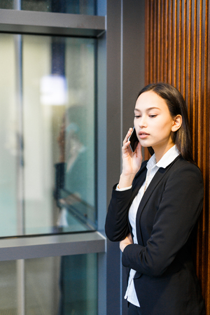 Attractive Businesswoman Answering on Phone Call Stock Photo