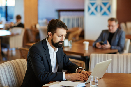 Confident Businessman Concentrated on Work