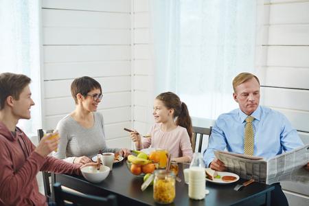 Enjoying Delicious Breakfast in Bosom of Family Stock Photo