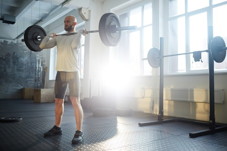 Heavy Lifting in Gym Stock Photo