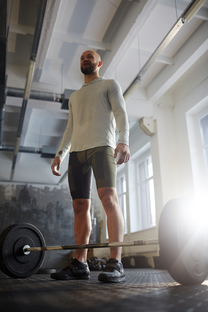 Strong Powerlifter Ready to Workout with Barbell Stock Photo