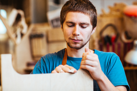 Young Carpenter Making Furniture Stock Photo