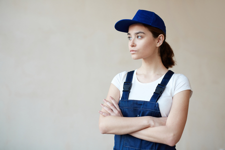 Woman in Workers Uniform Stock Photo