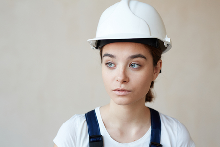 Portrait of Female Builder in Hardhat Stock Photo