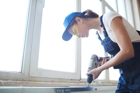 Female Worker Installing Windows