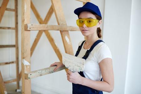 Female Builder Doing Plaster Works
