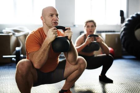 Doing Kettlebell Squat Exercise