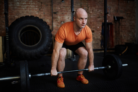 Fit Man Lifting Barbell