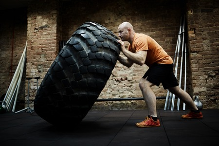 Athlete Focused on Tire Flipping
