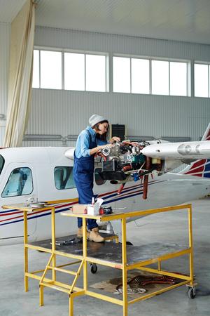 Female Mechanic Repairing Planes Stock Photo
