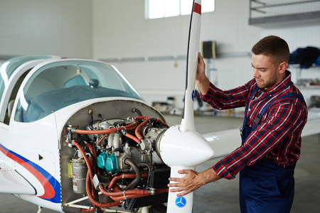 Modern Mechanic Repairing Jet Plane