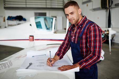 Handsome Jet Mechanic Stock Photo - 77574145