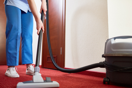 carpet clean: Cleaning carpet in hotel room