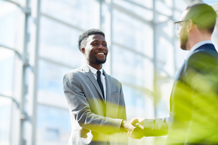 Business Partners Shaking Hands on Successful Deal