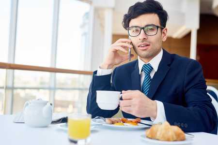 Calling by breakfast Stock Photo