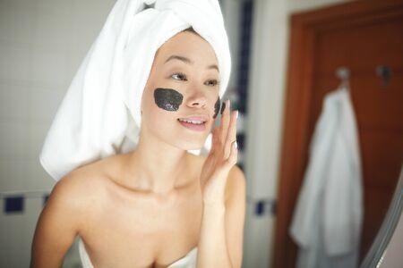 replenishing: Beautiful Woman Applying Face Cleaning Scrub Stock Photo