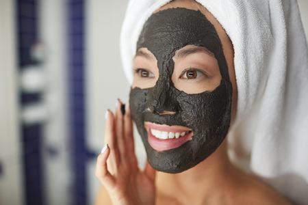 replenishing: Smiling Woman Using Beauty Treatment in Shower Stock Photo