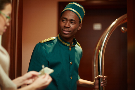 bellboy: Bellboy Getting Tips from Guests