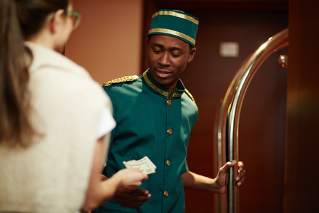 Guest Tipping Hotel Staff Stock Photo