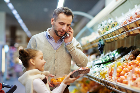 super market: Man Calling Wife from Grocery Store