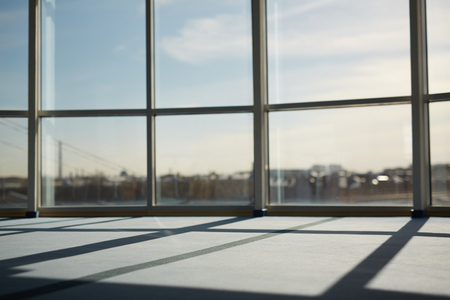 Part of modern office window with sunlight penetrating inside Stock Photo