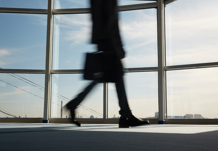 Blurred figure of businessman hurrying for work Stock Photo