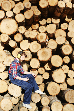Modern Lumberjack Using Smartphone