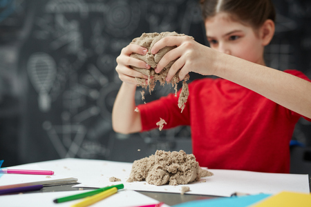 Little Girl Playing with Sand in Art Class