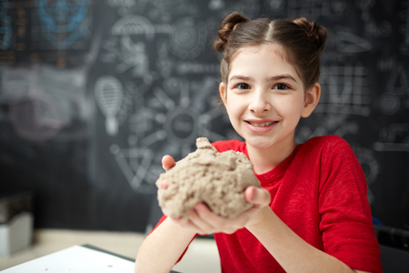 Little Girl Playing with Kinetic Sand