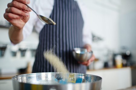 Putting salt in bowl