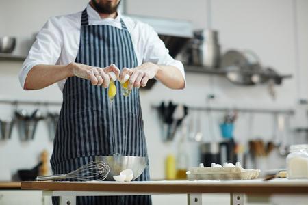 Breaking raw eggs