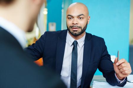 Persuasive Businessman Talking to Partner