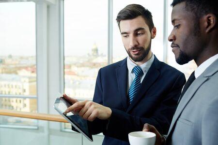break from work: Business People Discussing Work on Break