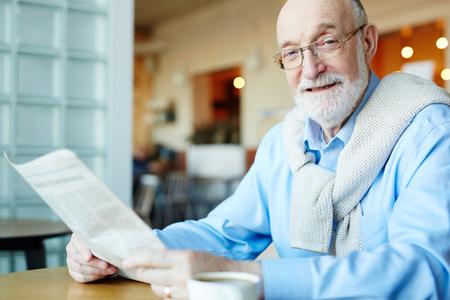Man reading news Stock Photo