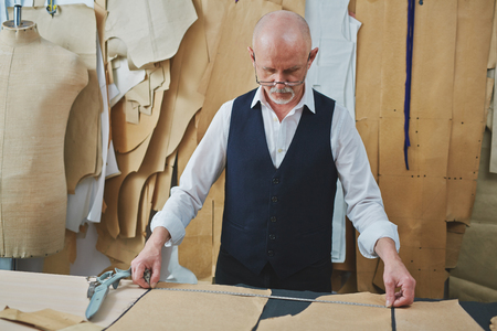 Experienced Tailor Making Bespoke Garments in Atelier