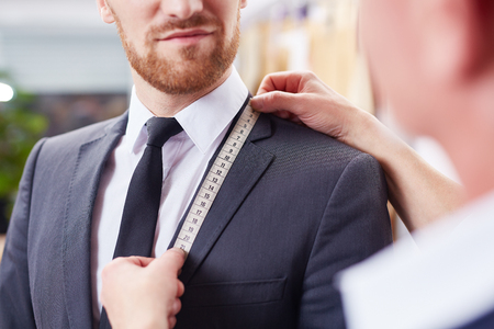 Tailor Taking Measurements in Atelier Reklamní fotografie - 79762322