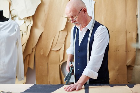 Skilled Senior  Tailor Working in Small Atelier