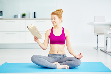 Smiling Yogi Woman Reading Book