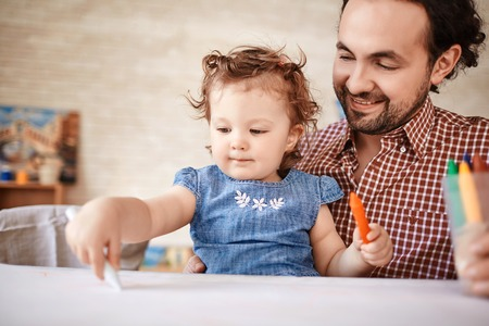 Father Playing with Cute Little Girl at Home